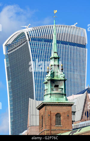 Green copper clad tower of All Hallows church at Tower Hill in the City of London with Walkie Talkie building at - Stock Photo