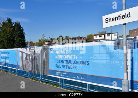 Crossrail adverts on  Network Rail construction site hoarding adding new platform & track to terminate trains Shenfield - Stock Photo