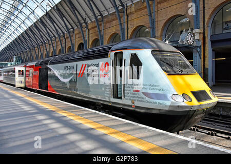 Locomotive 43238 at Kings Cross train station platform London England UK with promotional advertising for the National - Stock Photo