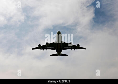 Emirates Airbus A380-800 passenger aircraft flying low overhead on landing approach to  Franz Josef Strauss Airport, - Stock Photo