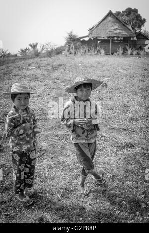 Burmese children playing in fields. Village near Mandalay, Myanmar, Burma, South Asia, Asia - Stock Photo