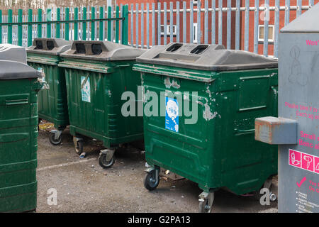 General waste and recycling bins or containers in a community recycling point - Stock Photo