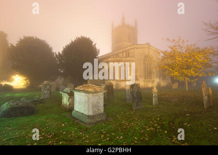 Saint Edward's Church in fog, Stow-on-the-Wold, Cotswolds, Gloucestershire, England, United Kingdom, Europe - Stock Photo