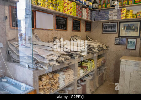 Shop selling Bacalhau, dried and salted cod fish, a popular item for Portuguese cuisine. - Stock Photo
