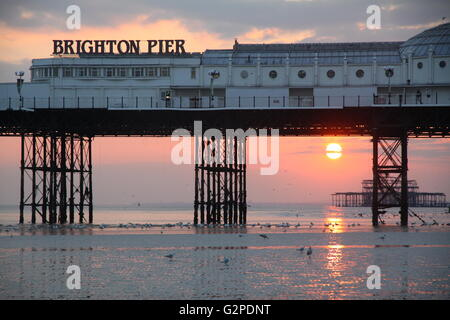 Brighton Pier and Beach with a nice sunset - Stock Photo