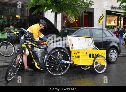 Berlin, Germany. 01st June, 2016. ILLUSTRATION - Road patrol driver Dirk Niessl stands with his e-bike assisting - Stock Photo
