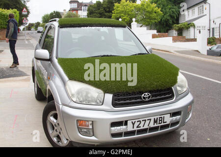 London, UK. 2nd June 2016. A car covered in grass as preparations are underway for the 2016 Wimbledon Tennis Grand - Stock Photo