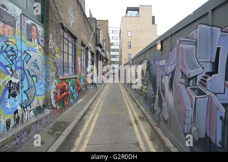 side alley covered in graffiti - Stock Photo