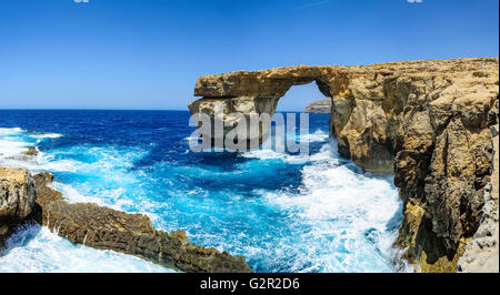 Panoramic view of the Azure Window, a limestone natural arch situated near Dwejra Bay at Gozo Island, Malta. - Stock Photo