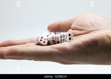 Human hand ready to roll the dice on white isolated background - Try luck, Take Risk or Business concept (Focus - Stock Photo