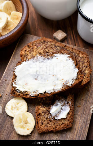 Butter on slices of banana bread - Stock Photo