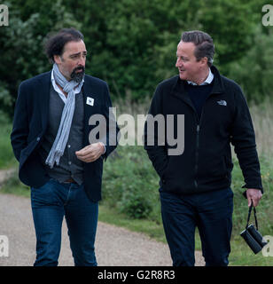 Prime Minister David Cameron is shown around Rainham Marshes RSPB nature reserve by impressionist Alistair McGowan. - Stock Photo