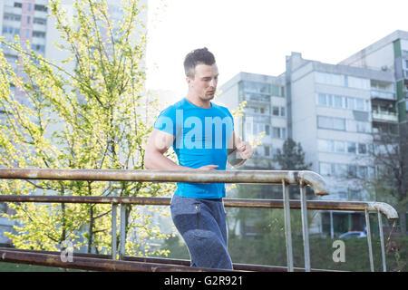 Street workout, confident sportsman - Stock Photo