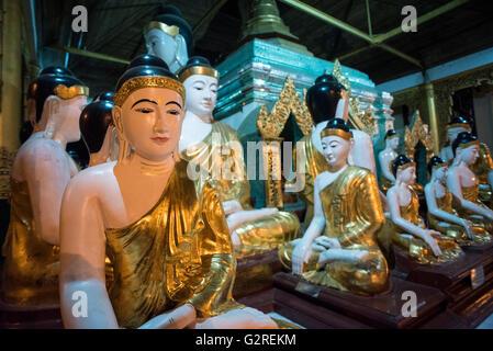 A group of Buddha statues at the Shwedagon pagoda in Yangon, Myanmar. - Stock Photo