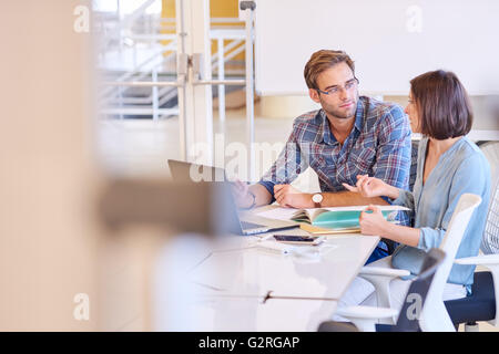 Business man and woman working together in conference room - Stock Photo