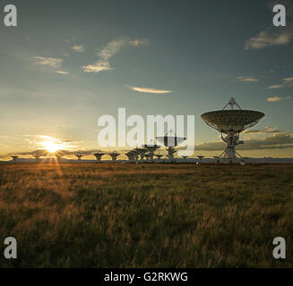 Satellite dishes in the Very Large Array in Socorro, New Mexico, at sunset - Stock Photo