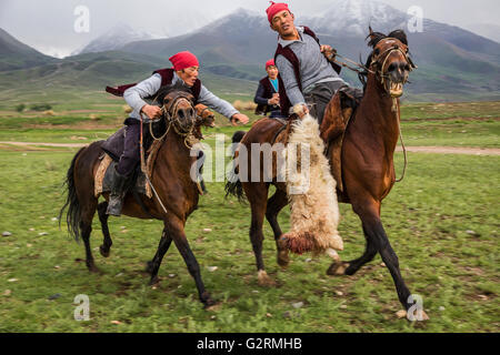 Traditional Nomadic horse games known also as goat polo, kokpar or buzkashi, in Issyk Kul Lake, Kyrgyzstan. - Stock Photo