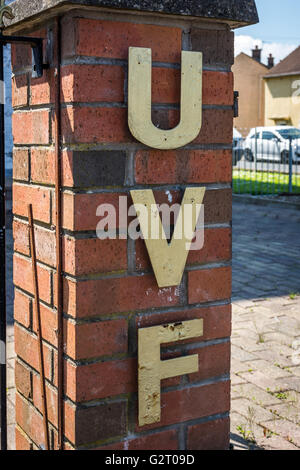 Metal Ulster Volunteer Force lettering attached to UVF memorial garden in Cregagh Estate in East Belfast, Northern - Stock Photo