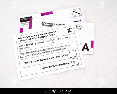 UK EU referendum postal voting papers. Brexit, exit. On tablecloth. - Stock Photo