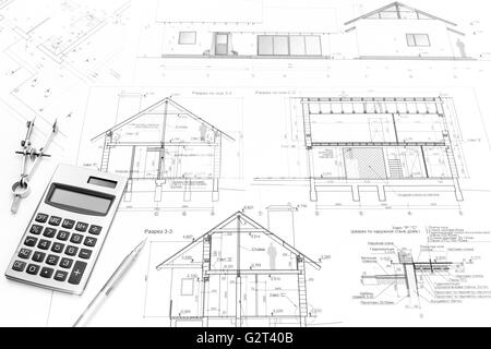 Architectural Drawings Of Modern Houses architectural drawings of modern house with calculator and pencil