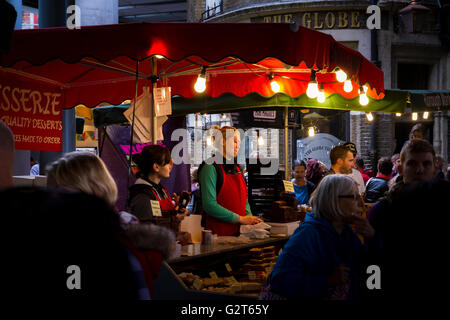 Market trader at a stall in Borough Market. Borough Market  is London's most renowned food and drink market with - Stock Photo