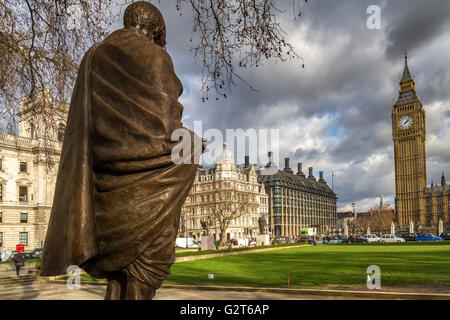 The bronze statue of Mahatma Gandhi by the sculptor Philip Jackson in Parliament Square,Westminster ,London, United - Stock Photo