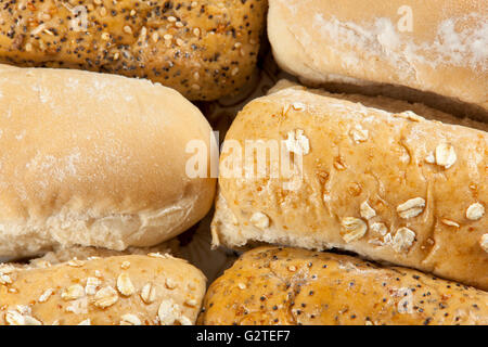 Close up shot of various types of bread finger rolls laying on a plate - Stock Photo