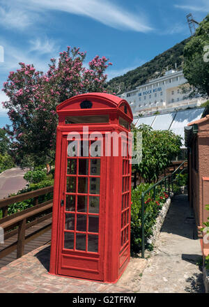 View from the Alameda botanic gardens, Gibraltar, towards a red phone box and The Rock Hotel - Stock Photo