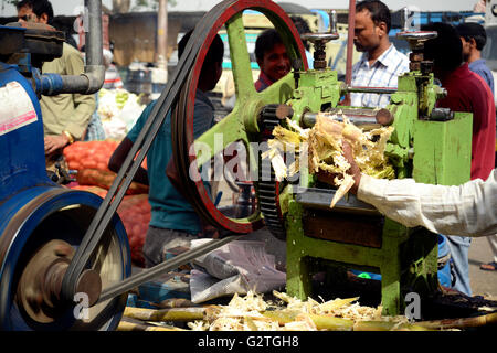 Sugarcane Crusher on Indian street - Stock Photo