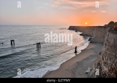 Sunset over Davenport Pier Beach - Stock Photo
