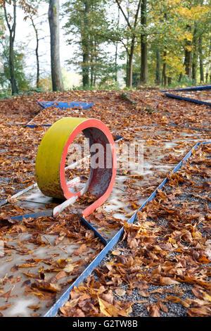 07.11.2014, Sinsheim, Baden-Wuerttemberg, Germany - Autumn leaves on miniature golf course. 0SH150923D063CAROEX.JPG - Stock Photo
