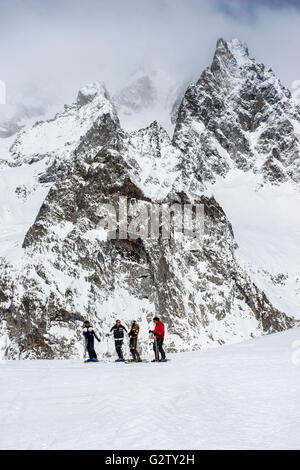 Skiers admiring the views in the ski resort of Courmayeur, Italy - Stock Photo