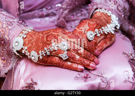Henna (Mehndi) skin decorations on a Muslim bride - Stock Photo