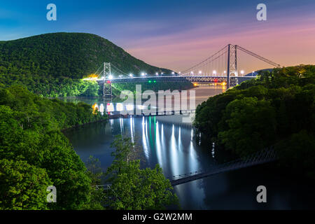 Hudson River valley with Bear Mountain bridge illuminated by night, in New York state - Stock Photo