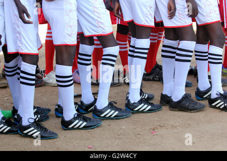 Budding soccer players line up for a football match - Stock Photo