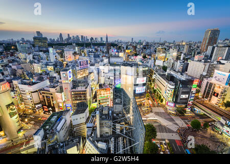 The Shibuya skyline at twilight in Tokyo, Japan. - Stock Photo