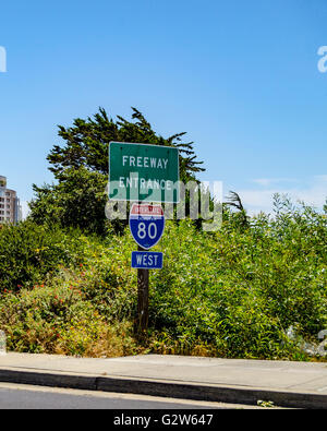 A Freeway entrance sign for Interstate 80 in Emeryville California. - Stock Photo