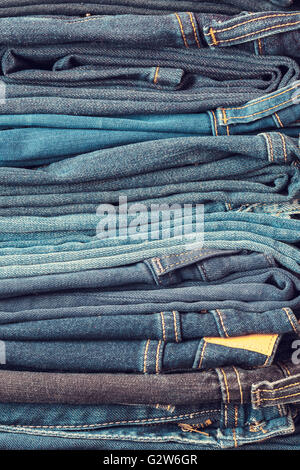 Stacked fashion blue jeans closeup - Stock Photo