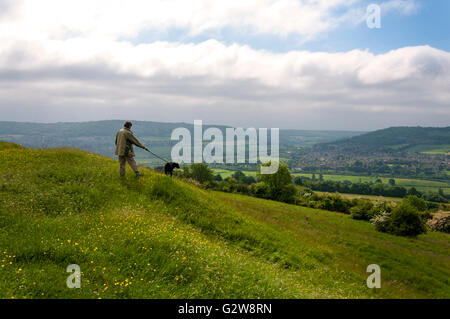 Little Solsbury Hill, Batheaston, Somerset. UK weather. 3rd June 2016. A dog walker admires the view from atop the - Stock Photo