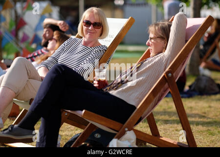 Hay Festival, Wales, UK - June 2016 -  As the evening starts the Festival lawns are still busy with people taking - Stock Photo