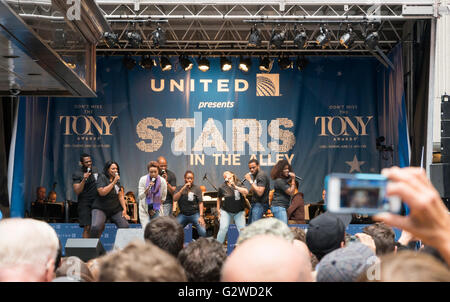 The cast of The Colour Purple Broadway production performing one of their songs at the free Stars in the Alley concert - Stock Photo