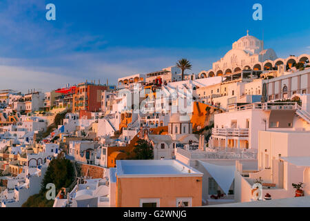 Fira at sunset, Santorini, Greece - Stock Photo
