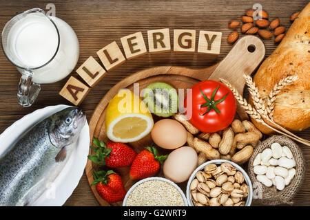 Allergy food concept. Allergy food as almonds, milk, pistachios, tomato, lemon, kiwi, trout, strawberry, bread, - Stock Photo
