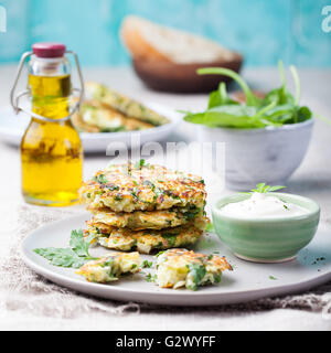 Cabbage and spinach pancakes with yogurt dressing - Stock Photo