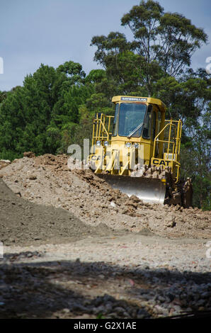 Excavators and earth moving equipment working on a construction site in Australia - Stock Photo