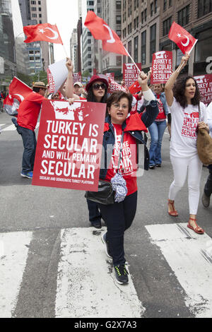 Proud Turkish Americans march in and watch the Turkish Parade in NYC and support keeping Turkey a democratic and - Stock Photo