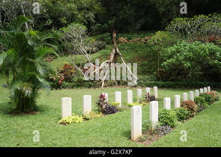 Headstones of British and South Asian soldiers fallen during the Second World War at Kandy War Cemetery, Sri Lanka. - Stock Photo