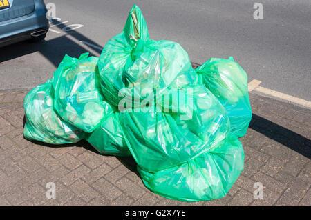 Plastic recycling bags on pavement, Church Road, Ashford, Surrey, England, United  Kingdom - Stock Photo