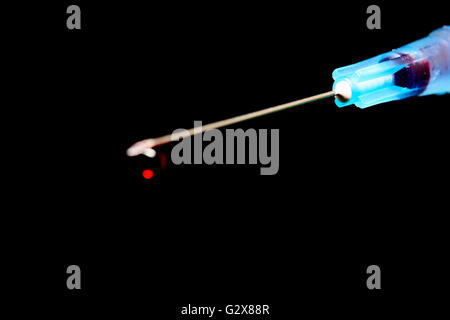 Hypodermic Needle, rear focus on syringe with needle point blurred - Stock Photo