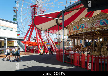 Ferris Wheel and carousel at Luna Park Sydney, Milsons Point, Sydney, New South Wales, Australia - Stock Photo